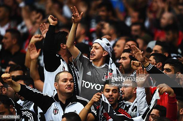 Besiktas fans support their team during the UEFA Champions League Qualifier 2nd leg match between Arsenal and Besiktas at the Emirates Stadium on...