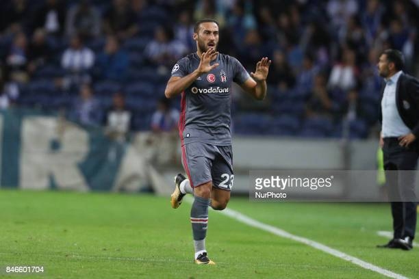 Besiktas' forward Cenk Tosun celebrates after scoring a goal during the FC Porto v Besiktas UEFA Champions League Group G round one match at Dragao...