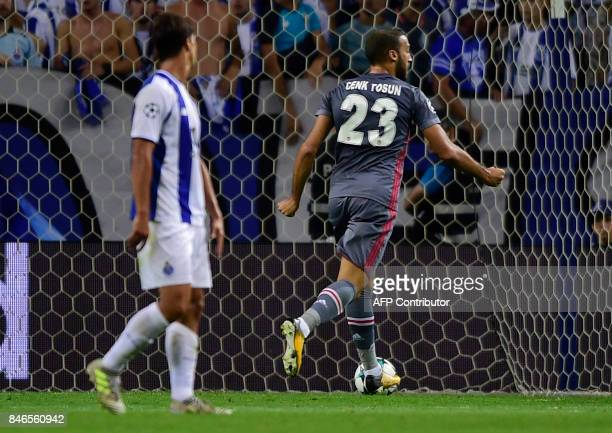Besiktas' forward Cenk Tosun celebrates after scoring during the UEFA Champions League football match FC Porto vs Beskitas JK at the Dragao stadium...