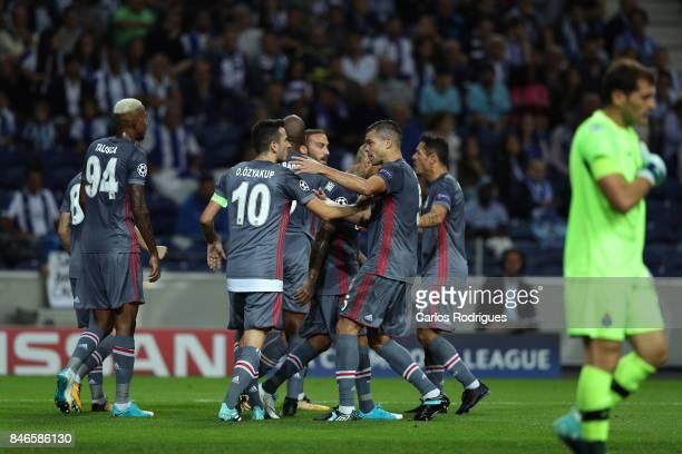 Besiktas forward Cenk Tosun celebrates scoring Besiktas second goa with his team mates during the match between FC Porto v Besiktas JK for the UEFA...