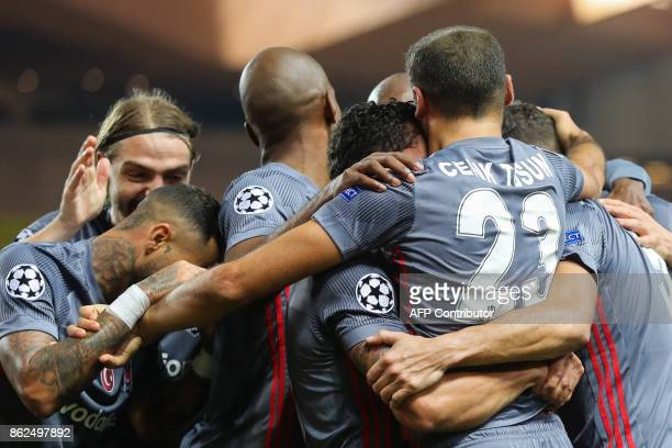 Besiktas' forward Cenk Tosun celebrates with teammates after scoring his second goal during the UEFA Champions League group stage football match...