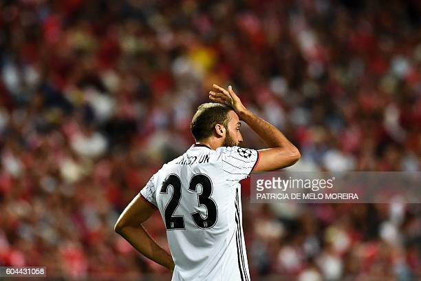 Besiktas' forward Cenk Tosun gestures after missing a goal during the UEFA Champions League football match SL Benfica vs Besiktas JK at the Luz...
