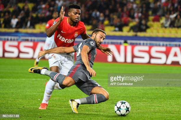 Besiktas' forward Cenk Tosun tackles the ball under pressure from Monaco's Brazilian defender Jemerson during the UEFA Champions League group stage...