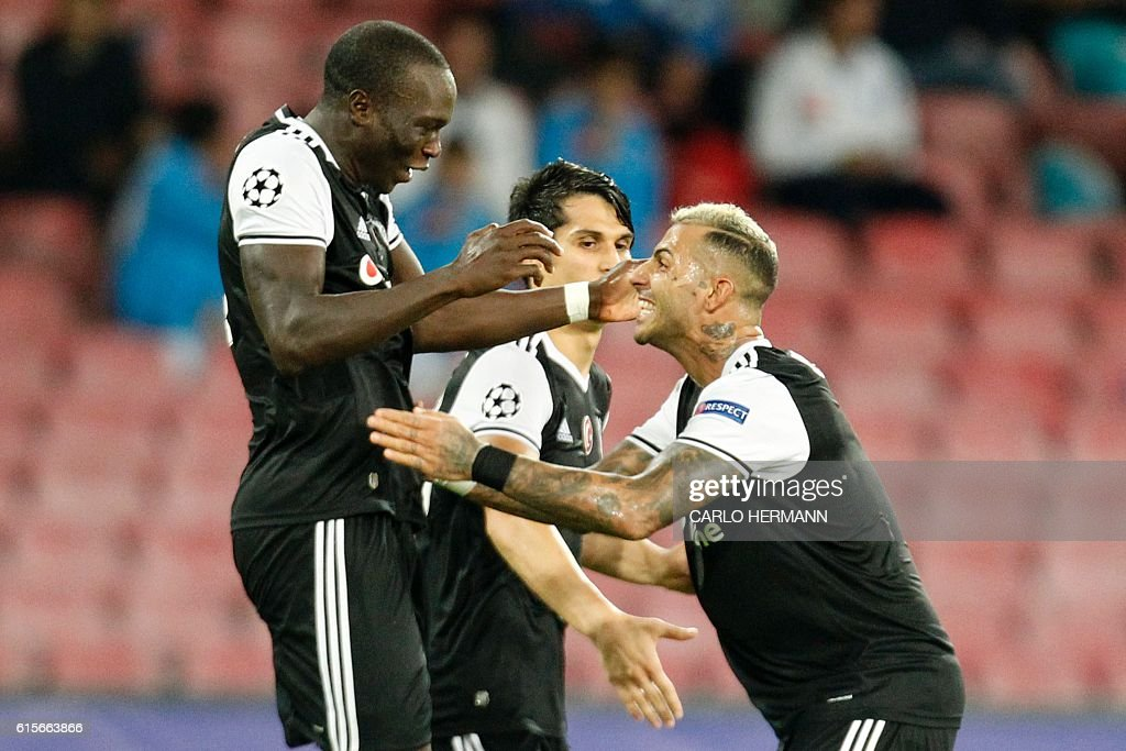 Besiktas' forward from Cameroon Vincent Aboubakar (L) celebrates with Besiktas' forward from Portugal Ricardo Quaresma after scoring during the UEFA Champions League football match SSC Napoli vs Besiktas on October 19, 2016 at the San Paolo stadium in Naples. / AFP / Carlo Hermann