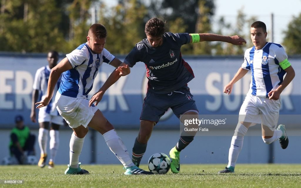 Besiktas forward Muhammed Ozturk from Turkey with FC Porto defender Diogo Queiros in action during the UEFA Youth League match between FC Porto and Besiktas JK at Centro de Estagios do Olival on September 13, 2017 in Olival, Portugal.