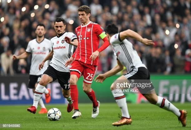 Besiktas forward Mustafa Pektemek looks on as Bayern Munich's German forward Thomas Mueller controls the ball during the second leg of the last 16...