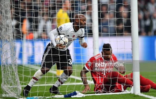 Besiktas forward Vágner Love picks the ball out of the net after scoring during the second leg of the last 16 UEFA Champions League football match...