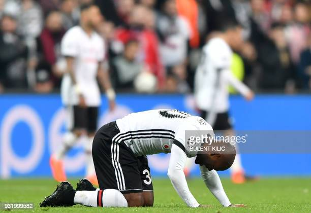 Besiktas forward Vágner Love reacts after a challenge during the second leg of the last 16 UEFA Champions League football match between Besiktas and...