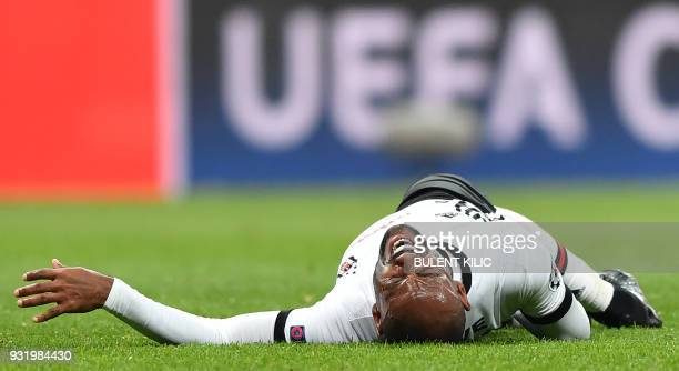 Besiktas forward Vágner Love reacts after a tackle during the second leg of the last 16 UEFA Champions League football match between Besiktas and...