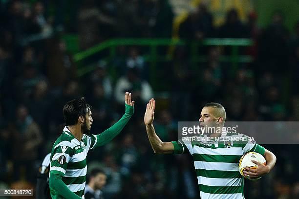 Besiktas' German forward Mario Gomez celebrates with his teammate Costa Rican forward Bryan Ruiz after scoring against Sporting CP during the UEFA...