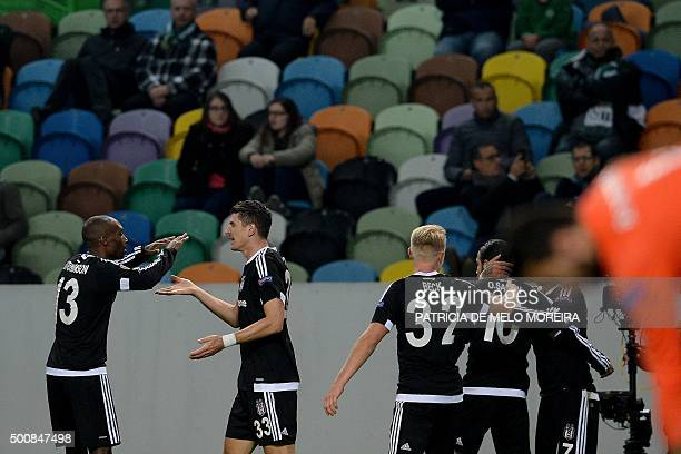 Besiktas' German forward Mario Gomez celebrates with his teammates after scoring against Sporting CP during the UEFA Europa League football match...