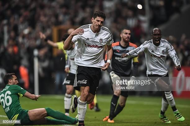 Besiktas' German forward Mario Gomez celebrates with his teammates after scoring during the Turkish Spor Toto Super league football match between...