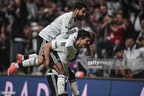 Besiktas' German forward Mario Gomez celebrates with teammates after scoring a goal against Bursaspor during the Turkish Spor Toto Super league...
