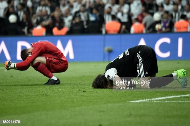 Besiktas' goalkeeper Fabricio Agosto Ramirez and defender Atinc Nukan react after Fenerbahce scored a goal during the Turkish Spor Toto Super Lig...