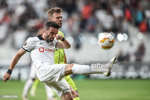 Besiktas' Gokhan Gonul vies for the ball with Sarpsborg's Patrick Mortensen during the UEFA European League Group I football match between Besiktas...