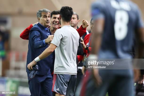 Besiktas' head coach Senol Gunes and Besiktas' staff react after winning the UEFA Champions League group stage football match between Monaco and...