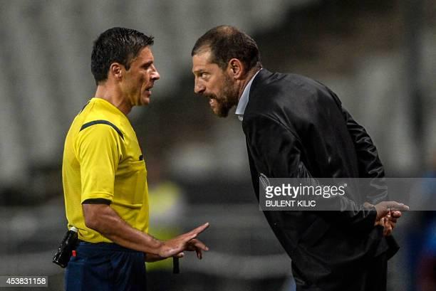 Besiktas' head coach Slaven Bilic argues with the referee Milorad Mazic during the UEFA Champions League playoff first leg football match Besiktas vs...