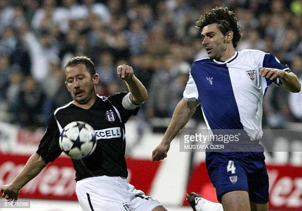 Besiktas Istanbul's defender Sergen Yalcin fights for the control of the ball with Athletico Bilbao's player Karanka Aitor during their UEFA cup...