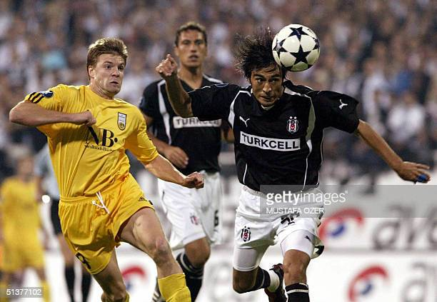 Besiktas Istanbul's Ibrahim Toraman fights for the control of the ball with Bodo Glim's Olav Rastad during their UEFA Cup first round second leg...
