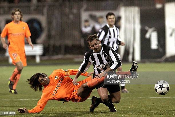 Besiktas Istanbul's Sergen Yalcin is tackled by Valencia's Fabian Ayala during their UEFA Cup third round second leg football match 03 March 2004 in...