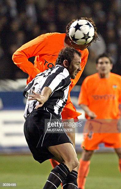 Besiktas Istanbul's Sergen Yalcin vies with Valencia's Fabian Ayala during their UEFA Cup third round second leg football match 03 March 2004 in...