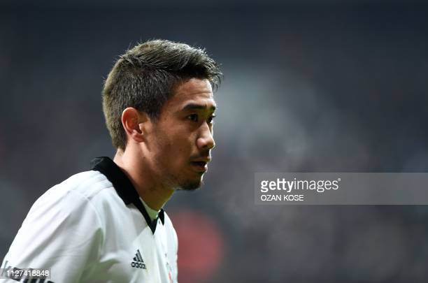Besiktas' Japanese forward Shinji Kagawa looks on during the Turkish Super Lig football match between Besiktas and Fenerbahce on February 25 at the...