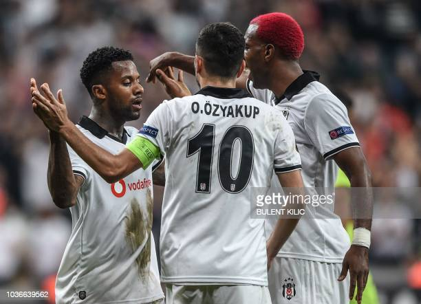 Besiktas' Jeremain Lens celebrates with teammates after scoring a goal during the UEFA European League Group I football match between Besiktas and...