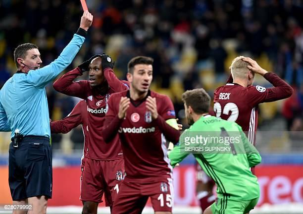 Besiktas JK 's Russias defender Andreas Beck reacts with his teammates Tukish midfielder Oguzhan Ozyakup and Spanish goalkeeper Fabricio Agosto...