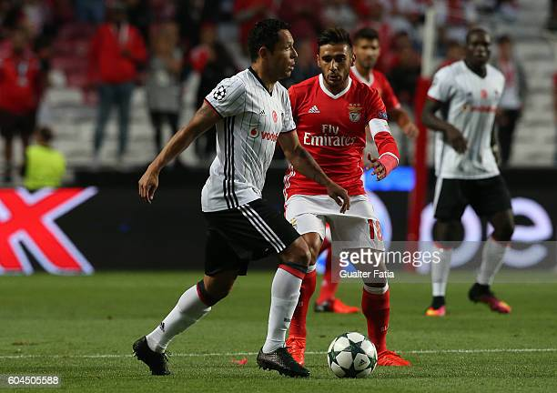 Besiktas JKÕs defender Adriano with SL BenficaÕs midfielder from Argentina Salvio in action during the UEFA Champions League match between SL Benfica...
