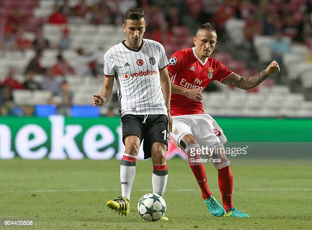 Besiktas JK's midfielder Oguzhan Ozyakup with SL Benfica's midfielder from Serbia Ljubomir Fejsa in action during the UEFA Champions League match...