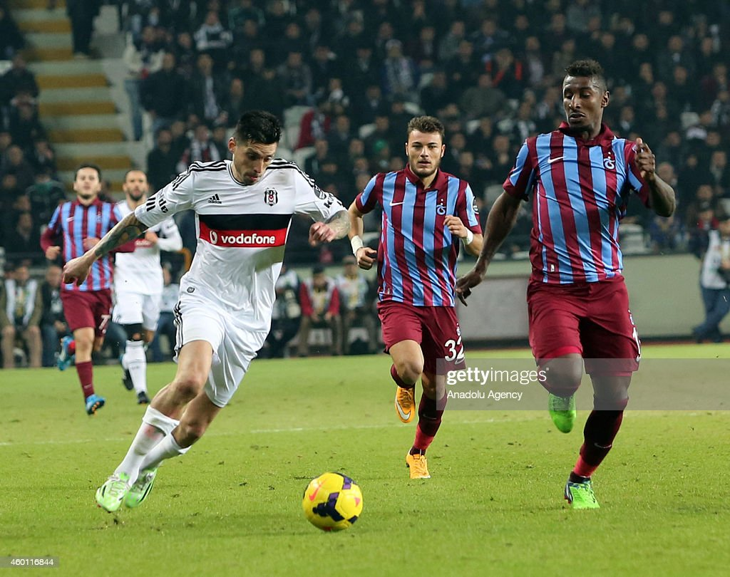 Besiktas' Jose Sosa vies for the ball with his rivals