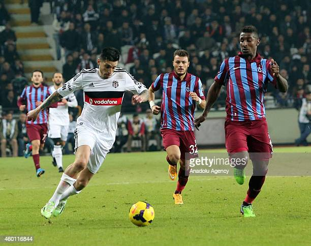 Besiktas' Jose Sosa vies for the ball with his rivals during the Turkish Super Toto Super League soccer match between Besiktas and Trabzonspor on...