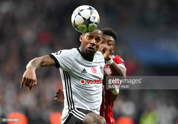 TOPSHOT Besiktas midfielder Jeremain Lens fights for the ball with Bayern Munich's Austrian defender David Alaba during the second leg of the last 16...