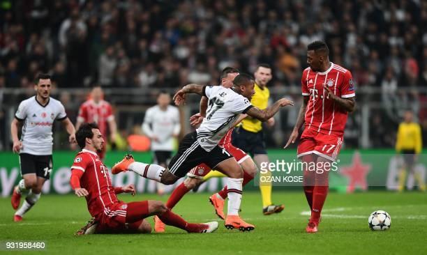 Besiktas midfielder Jeremain Lens is tackled by Bayern Munich's German defender Mats Hummels and Bayern Munich's German defender Jerome Boateng...