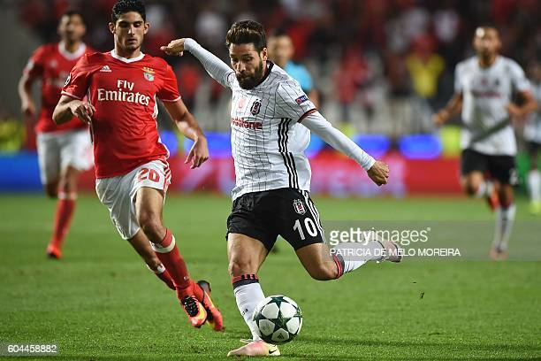 Besiktas' midfielder Olcay Sahan vies with Benfica's forward Goncalo Guedes during the UEFA Champions League football match SL Benfica vs Besiktas JK...