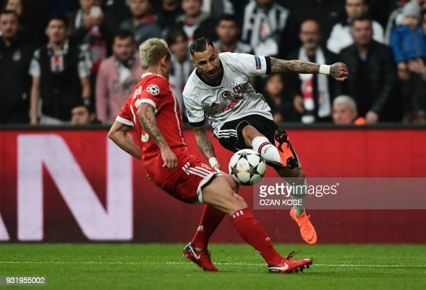 Besiktas midfielder Ricardo Quaresma fights for the ball with Bayern Munich's Brazilian defender Rafinha during the second leg of the last 16 UEFA...