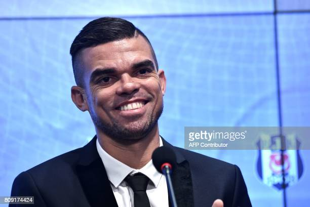 Besiktas' new Portuguese defender Pepe smiles during his signing ceremony with the club on July 5 at the Vodafone Park stadium in Istanbul Portuguese...
