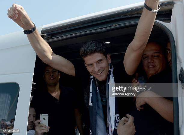 Besiktas' new transfer German Mario Gomez greets his fans as he arrives to Ataturk Airport in Istanbul Turkey on July 30 2015