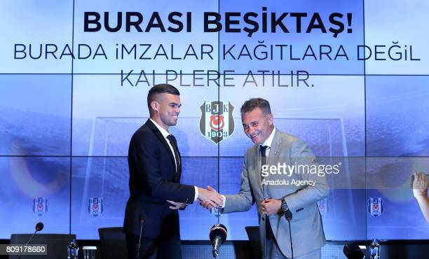 Besiktas' new transfer Pepe and Besiktas' President Fikret Orman shake hands during a signing ceremony at Vodafone Park in Istanbul Turkey on July 05...