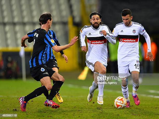 Besiktas' Olcay Sahan and Oguzhan Ozyakup in action during the UEFA Europa League Round of 16 First leg match between Club Brugge and Besiktas at Jan...