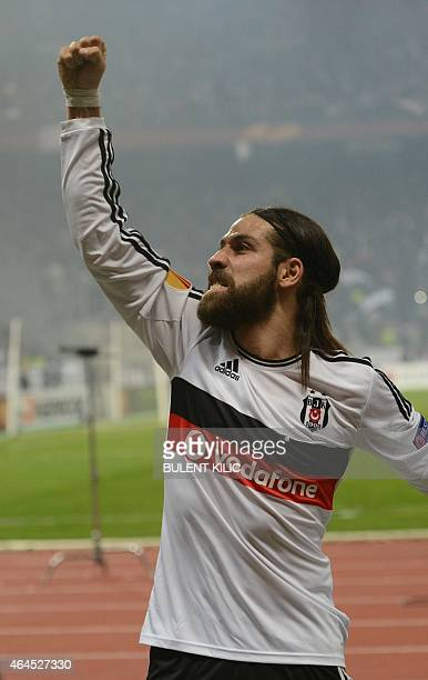 Besiktas' Olcay Sahan celebrates after his team scored during the UEFA Europa League round of 32 second-leg football match between Liverpool and...