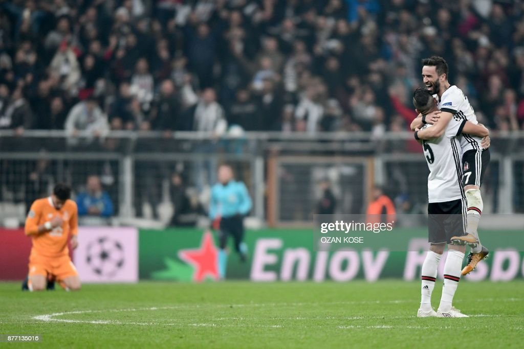 Besiktas' Pepe and Gokhan Gonul celebrate at the end of the UEFA Champions League Group G football match between Besiktas JK and FC Porto on November 21, 2017 at the Vodafone Park in Istanbul. Turkish champions Besiktas reached the Champions League last 16 for the first time in 31 years, as a 1-1 draw with Porto in Istanbul wrapped up top spot in Group G. /