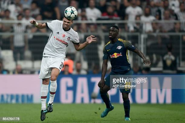 Besiktas` Pepe heads the ball next to Leipzig's Jean Kevin Augustin during the UEFA Champions League group G football match between Besiktas and RB...
