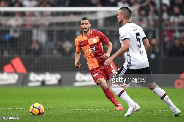 Besiktas' Pepe vies for the ball with Galatasaray's Younes Belhanda during the Turkish Super Lig football match between Besiktas and Galatasaray on...