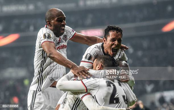 TOPSHOT Besiktas' players celebrate after scoring a goal during their UEFA Europa League round of 16 second leg football match between Besiktas JK...