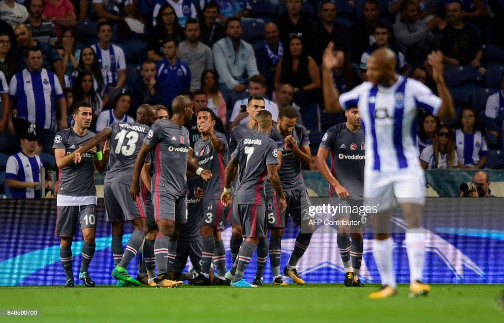 Besiktas' players celebrate after scoring during the UEFA Champions League football match FC Porto vs Beskitas JK at the Dragao stadium in Porto on September 13, 2017. /
