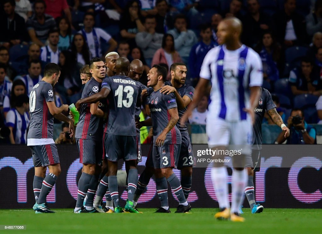Besikta's players celebrate after scoring their second goal during the UEFA Champions League football match FC Porto vs Beskitas JK at the Dragao stadium in Porto on September 13, 2017. /