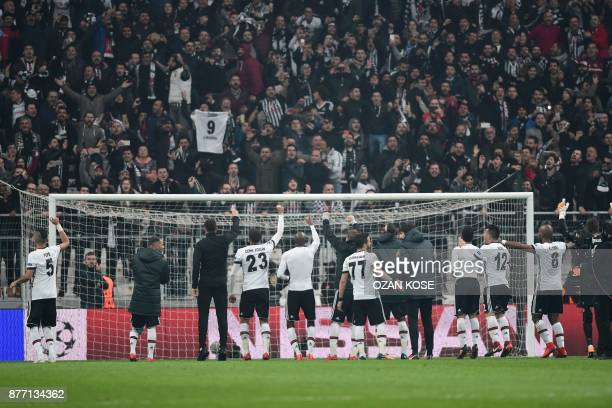 Besiktas' players celebrate at the end of the UEFA Champions League Group G football match between Besiktas JK and FC Porto on November 21 2017 at...