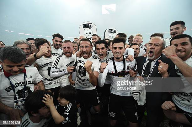TOPSHOT Besiktas' players celebrate their 20152016 champion title after winning the Turkish Super Toto league football match between Besiktas and...