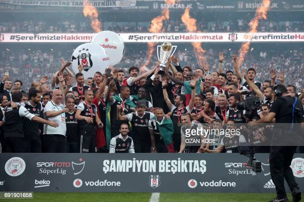 Besiktas' players celebrate their 20162017 Turkish league champion title after the Turkish Spor Toto Super league football match between Besiktas and...